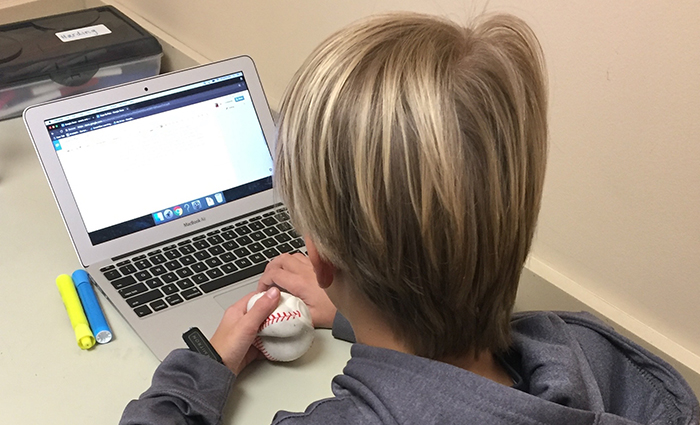 Photo of student using baseball fidget