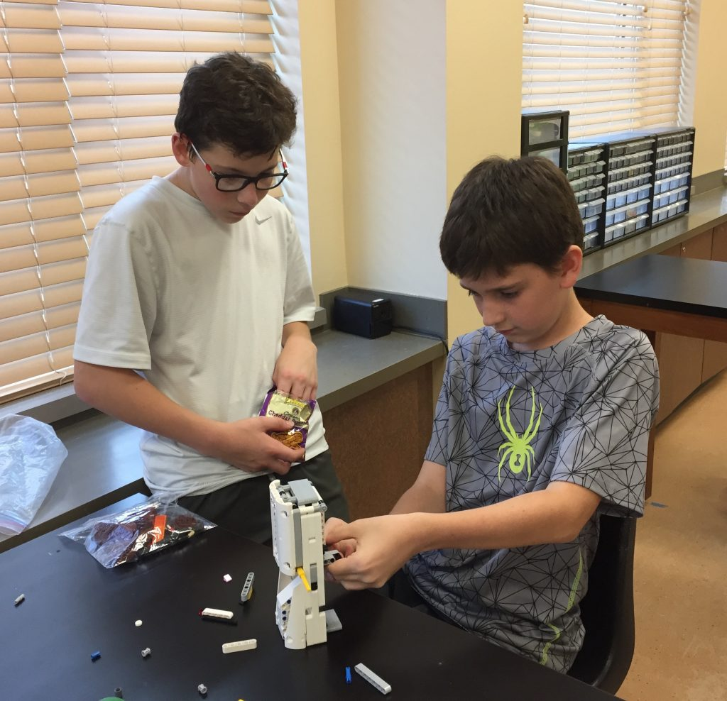 Photo of students working with Legos in science class at Churchill
